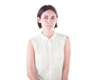 An awkward lady isolated on a white background. A funny and curious girl. A pretty lady in a white blouse. Successful student. royalty free stock images