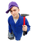 Awkward repairman with hammer Stock Image
