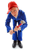 Awkward repairman with hammer Royalty Free Stock Photography