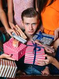 Awkward young male at Christmas party Stock Image