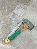 Awl and hammer on concrete flooring Royalty Free Stock Images