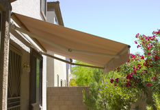 Awning. Above back yard door to residential two-storied house stock photo
