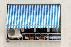 Awning. Blue and white awning in a street stock photos