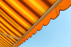 Awning. Bright orange awning with sky stock photos