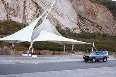 Awning and car. Shade awning in dalian, china royalty free stock images