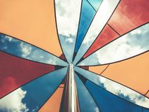 Awning in the midday sun against the sky.  royalty free stock photo