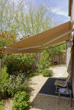 Awning Retracted over Doorway. Arizona backyard with automatic retractable awning for extra shade Stock Images