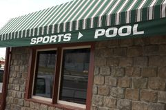 Awning - Sports and Pool. An awning over a Bar saying Sports and Pool Stock Photography