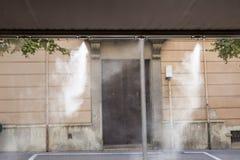 Awning sprinklers splashing water at terrace bar Stock Image
