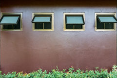 Awning windows on concrete wall Royalty Free Stock Photo
