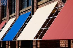 Awnings. Maroon, Blue & White Awnings Room for Text stock photos