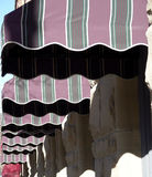 Awnings in a Row. Row of awnings in the mid afternoon sun Royalty Free Stock Image