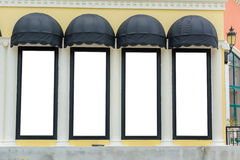 Awnings with yellow wall. Copy space Royalty Free Stock Image