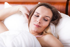 Awoken woman in bed Royalty Free Stock Images