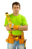 Aworker with toolbelt and construction level Stock Photos