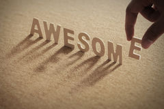 AWSOME wood word on compressed or corkboard Royalty Free Stock Photos