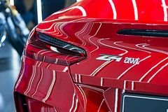 4 awt logos on the back of the red BMW Z4 sport car stock photography