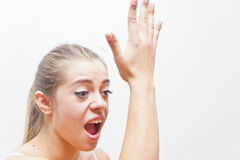 Awww now I remember what I forgot!. Girl making a gesture of a little beat in her front meaning she forgot something and now she remembers what Stock Photos