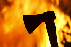 Ax against a background of fire Royalty Free Stock Photos
