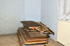 Ax and chisel. On the broken old furniture in the empty room with radiator and curtain stock photo