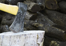 Ax on chopping block wood Royalty Free Stock Images