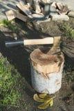Ax chopping wood on chopping block Royalty Free Stock Photo
