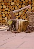 Ax and firewood Stock Images