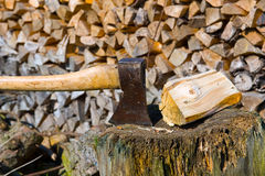 Ax and firewood Royalty Free Stock Images