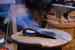Ax after forging. Metal steaming Royalty Free Stock Photography