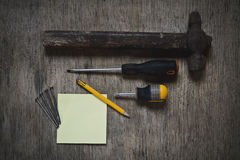 ax, a hammer, a screwdriver and nails Stock Image