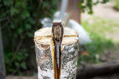 Ax, hatchet, axe. split a log with an ax. The brow in the background Royalty Free Stock Photo