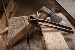 Ax or hatchet and pliers Stock Images