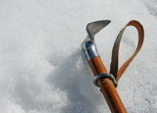 Ax hook firmly fixed in a wall of ice Royalty Free Stock Photography