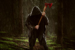 Ax Killer. In the rainy wood Royalty Free Stock Images