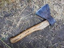 The ax lies on the ground. Stock Photos