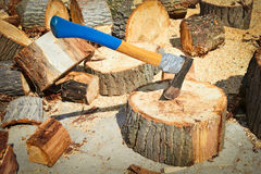 Ax stuck in a log of wood Royalty Free Stock Images