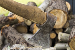 An ax stuck in a stump stock images