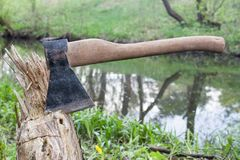 Ax stuck in a wood. Ax stuck in a block of wood Royalty Free Stock Photo