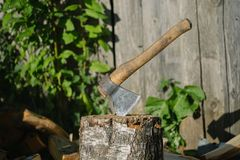 Ax thrust into the log. Outdoors photo Royalty Free Stock Image
