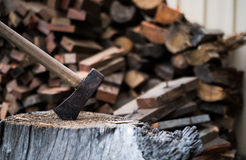 Ax in timber block with firewood Stock Photos
