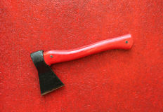 Axe. On red board background Royalty Free Stock Photos