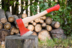 Axe. Red axe, log and firewood Royalty Free Stock Images