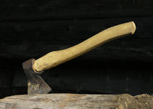 Axe. An axe sitting in a log Royalty Free Stock Image
