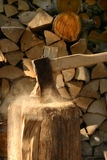 Axe in action. Chopping wood on a warm autumn day Stock Photo