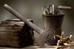 Axe with basket of many tools Stock Photography