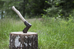 Axe and block. Old axe on chopping block in the countryside Stock Image