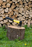 Axe in the block. And dry firewood in the background royalty free stock photos