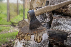 the axe on the block of wood stock image