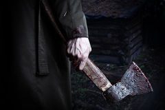 Axe with blood in male hand royalty free stock photo