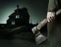 Axe with blood in male hand. stock image